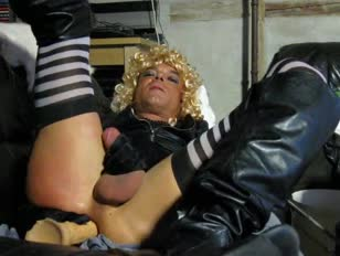 Slutty blonde masturbates with gloves and vibrators