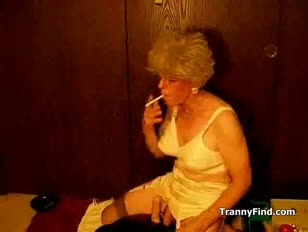 Mature crossdresser smoking