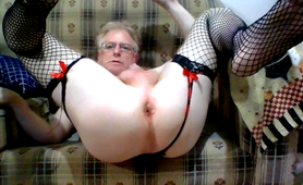 Masturbating in fishnets with an anal dildo