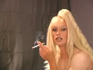 Hot lingeried blonde crossdresser likes smoking