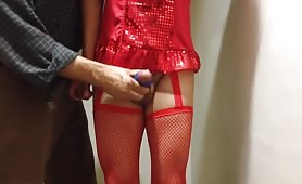 Crossdresser in Red Stockings Gets Nice Handjob for a Christmas